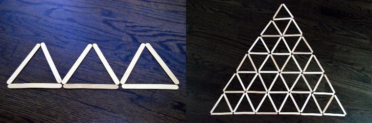 Craft sticks form a pyramid of triangles.