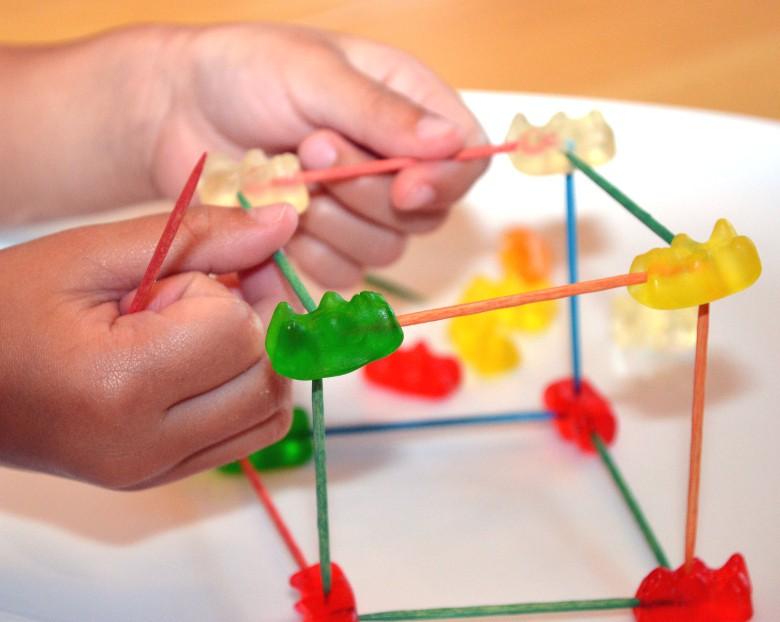 Child makes a gummies bears 3D sculpture