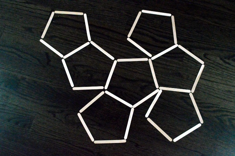 Craft sticks form pentagon pattern.