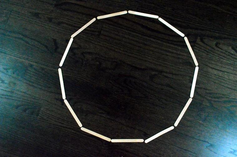 craft sticks form a large circle.