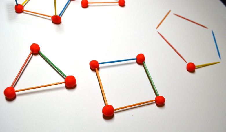 geometric shapes: triangle square pentagon built using toothpicks and playdoh.