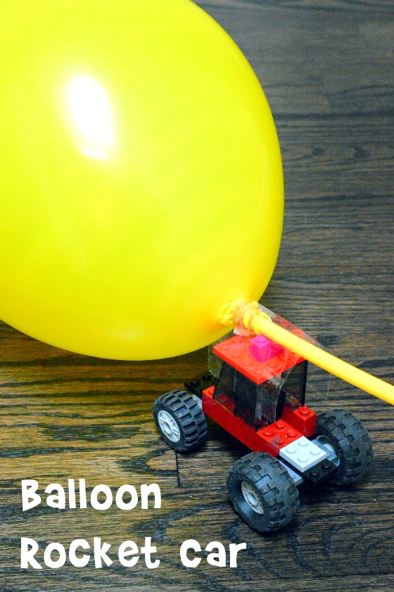 balloon attached to toy car and a straw