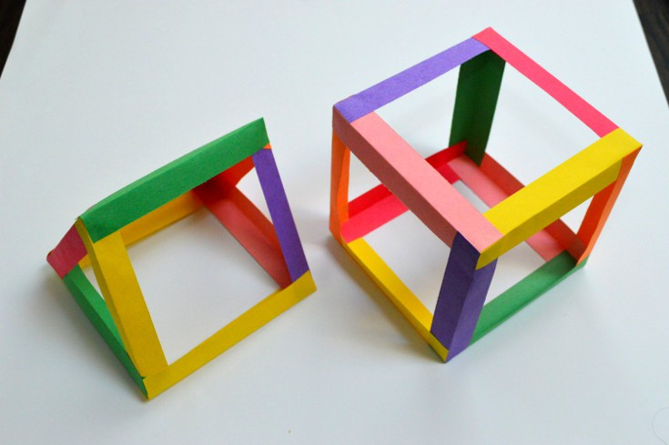a cube and a prism made from the color strips