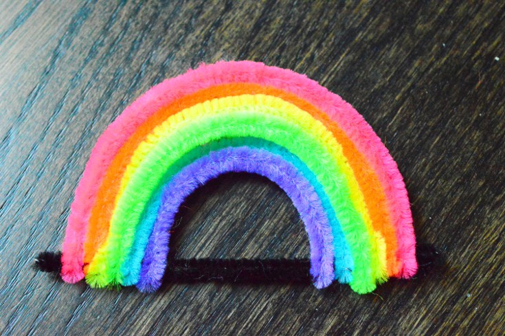Bend the colored pipecleaners to make a rainbow as a base for growing crystals for kids.