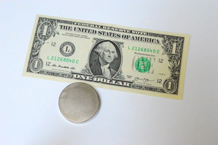 one dollar bill and a strong magnet