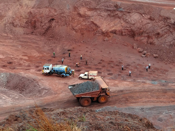 Trucks are sending soil away from the Iron ore. how to extract iron from soil.