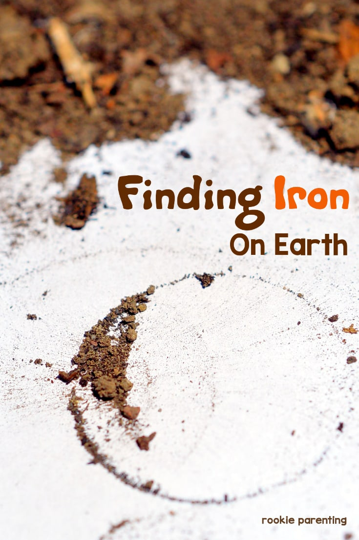 Soil on a piece of paper. An extract iron from soil experiment pin.