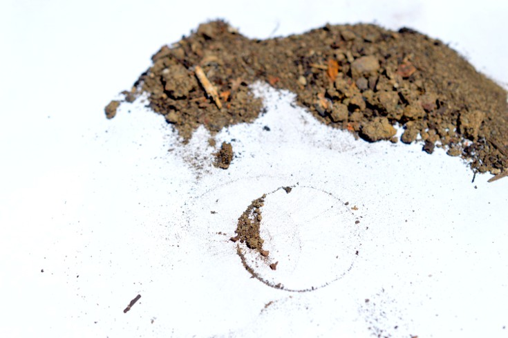 A circle of soil separated from the pile of soil