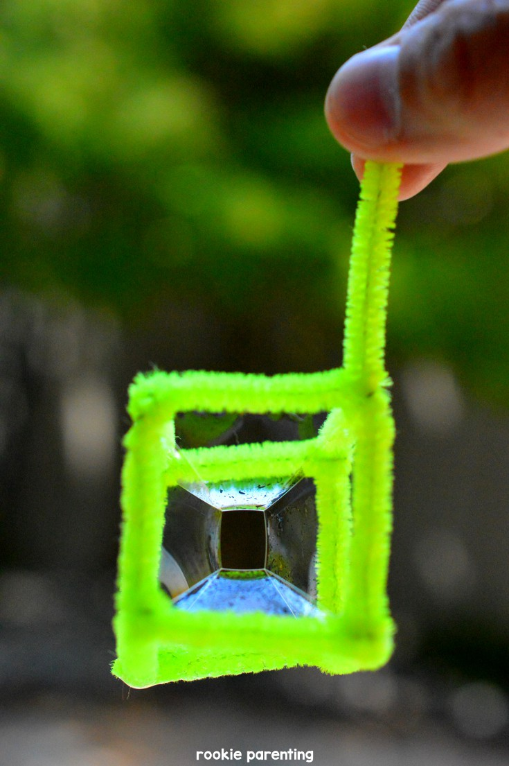square cube soap bubble made with green pipe cleaners