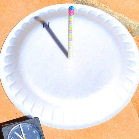 sundial made from paper plate and pencil