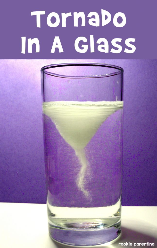 A tall glass with tornado shapped water inside. Make your own water tornado.