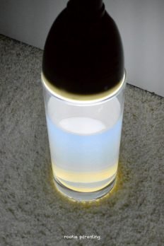 When white light lights up a glass of water from the top, the bottom of the water turns orange